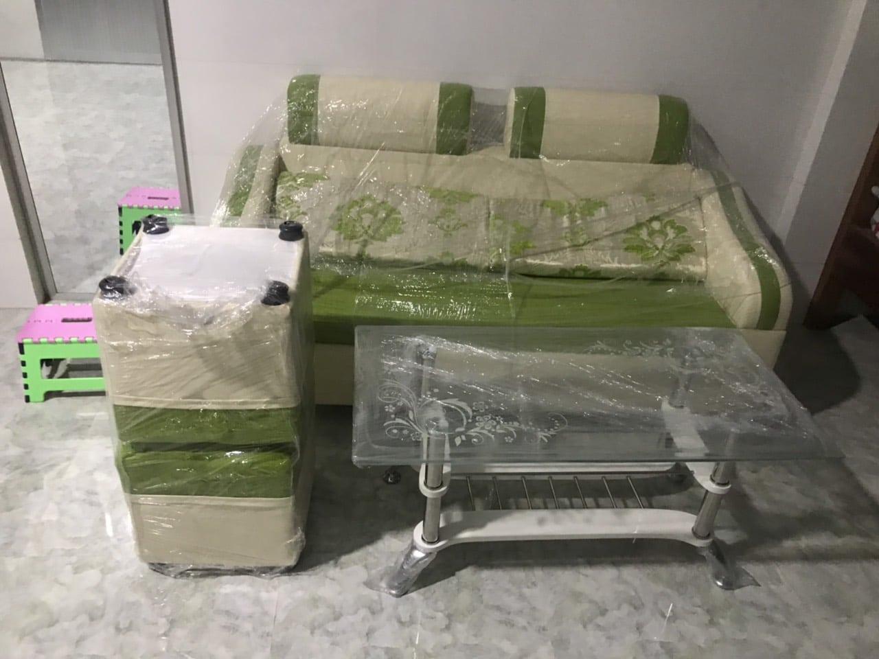 Sofa phòng khách giao cho khách